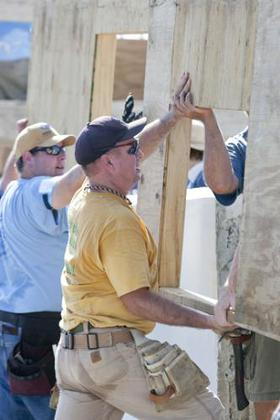 Garth Brooks helps move a wall into place during Habitat for Humanity's 2011 Jimmy & Rosalynn Carter Work Project in the Santo community in Haiti.
