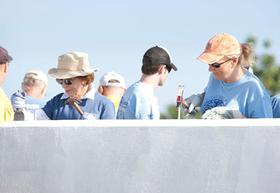 Trisha Yearwood works alongside Rosalynn Carter during Habitat for Humanity's 2011 Jimmy & Rosalynn Carter Work Project in the Santo community in Haiti.