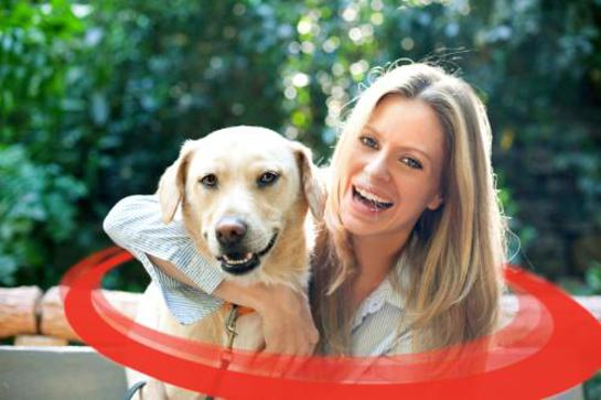 Kristin Bauer, pictured with her labrador retriever Ozmand, proudly supports WSPA's Collars Not Cruelty campaign