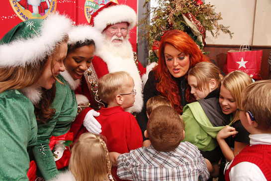 Wynonna Hugs Children