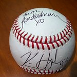 Kim Kardashian And Kris Humphries Sign Baseball For Charity Auction