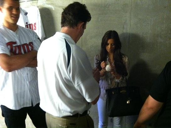 Kim Kardashian Signs Ball