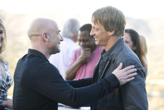 Andre Agassi greets skateboard legend Tony Hawk at philanthropic boot camp
