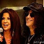 Slash Presents Charity Check At GuitarTown Launch