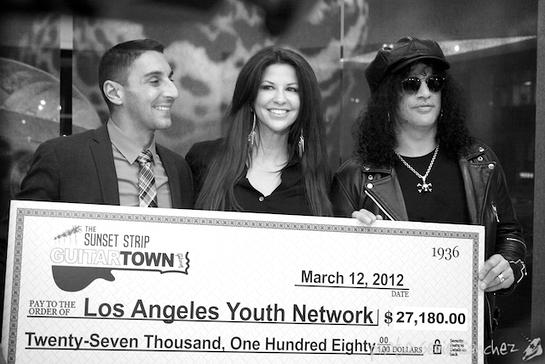 Perla and Slash Present Charity Check