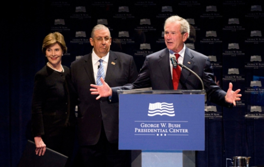 George W. Bush is joined by Mrs. Laura Bush and Dr. Angel Garrido at the launch of the Bush Center's Freedom Collection in Dallas