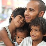 Lewis Hamilton Visits Street Children In The Philippines