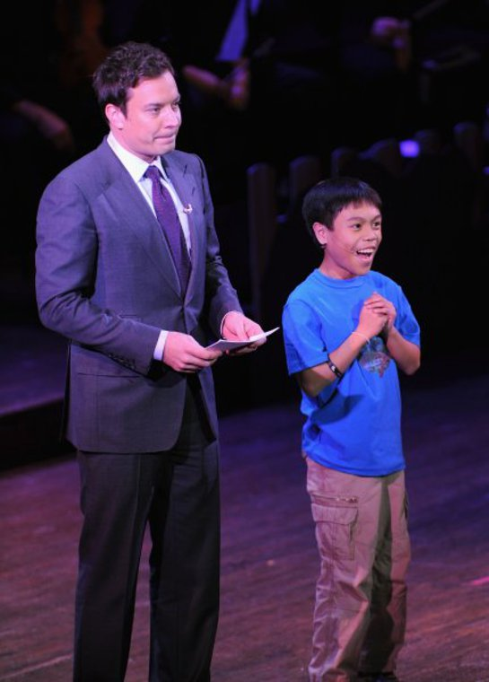 Jimmy Fallon performs with a Hole In the Wall camper during a Celebration of Paul Newman's Dream to Benefit the SeriousFun Children's Network