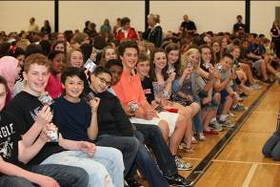 Central Middle School students pose for a photo showing off their new ear foamies courtesy of Starkey Hearing Foundation.