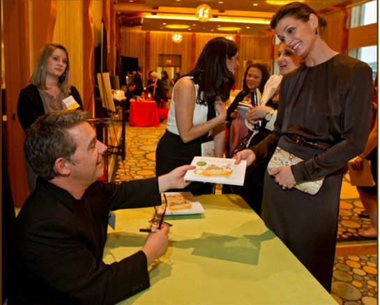 Peter H. Reynolds autographs a book for event special guest Bridget Moynahan.