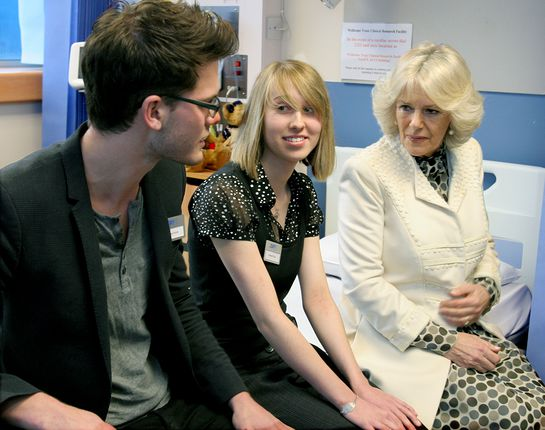 HRH The Duchess of Cornwall speaking with Jeremy Irvine, star of recent Hollywood blockbuster 'War Horse' and Hannah Day at the Addenbrooke visit