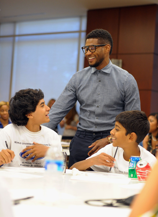 Usher visits with New Look youth