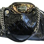 Autographed Handbags Raise Charity Cash