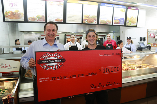 Boston Market CEO George Michel (A.K.A. The Big Chicken) presents a $10,000 check to pro skateboarder Ryan Sheckler at Boston Market