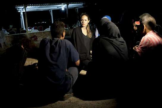 Angelina Jolie meets with refugees on the Jordanian border minutes after they crossed from Syria.