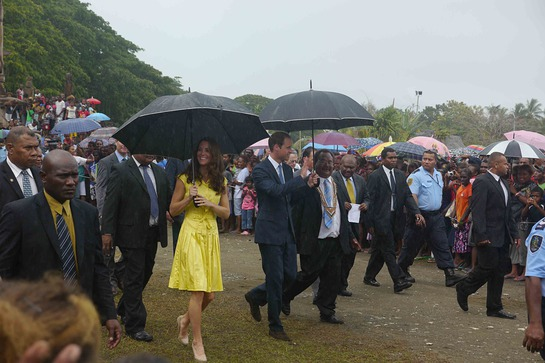 Duke and Duchess brave the rain to learn more about poverty and village life in the Solomon Islands.