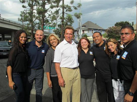 Arnold Schwarzenegger pictured with All-Star executives and staff members.