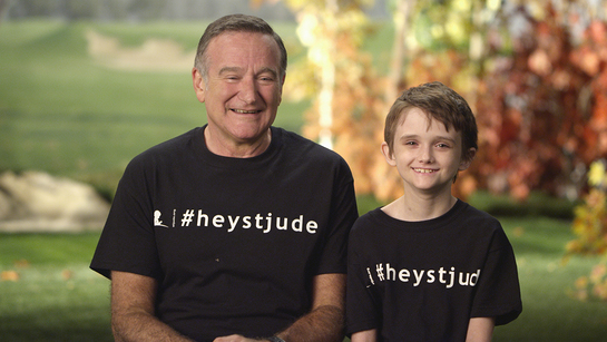 Robin Williams and St. Jude patient Brennan share a laugh while filming the new Hey Jude video.