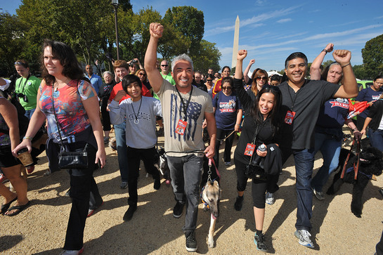 Cesar Millan leads participants and their pets around the National Mall at the Second Annual National Family Pack Walk