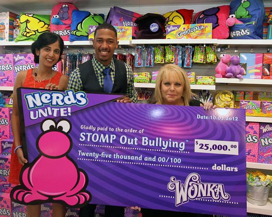 Natasha Madan, Wonka Marketing Manager, left, Nick Cannon, actor and STOMP Out Bullying Global Ambassador, center, and Ross Ellis, founder and CEO of STOMP Out Bullying join Wonka to celebrate NERDS Unite!