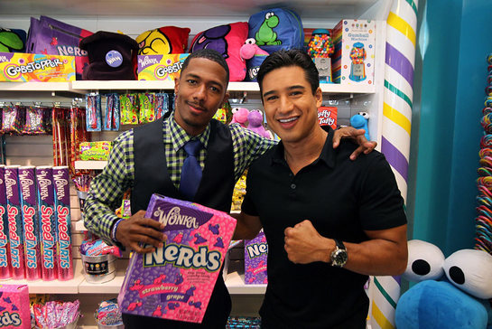 Nick Cannon, actor and STOMP Out Bullying Global Ambassador, left, poses with Mario Lopez after joining Wonka to celebrate NERDS Unite!