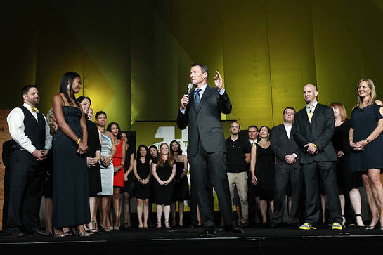 Lance Armstrong is joined on-stage at LIVESTRONG's 15th anniversary gala by Doug Ulman, LIVESTRONG President and CEO, and the foundation's staff, many of whom are cancer survivors.