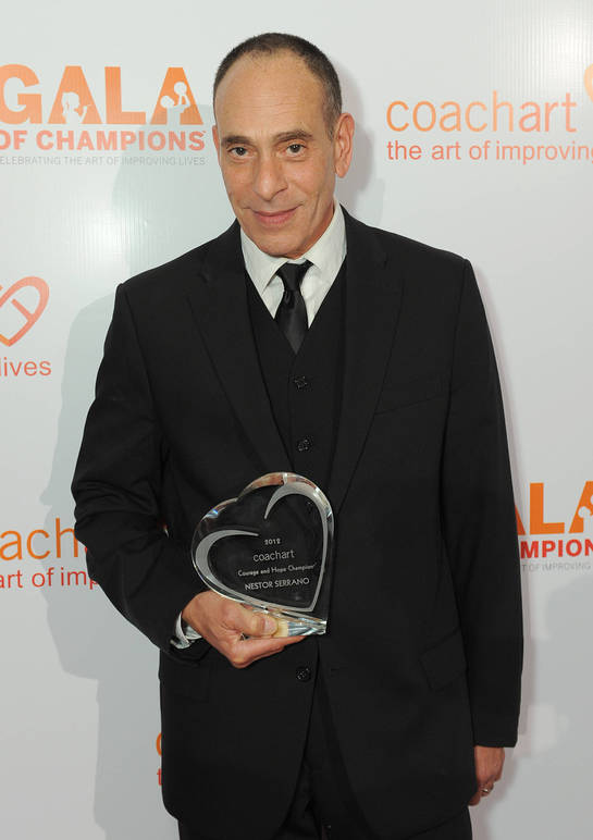 Nestor Serrano and his award on the red carpet