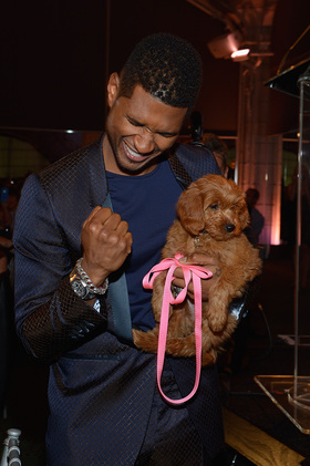 Usher and friend at Pencils of Promise Gala