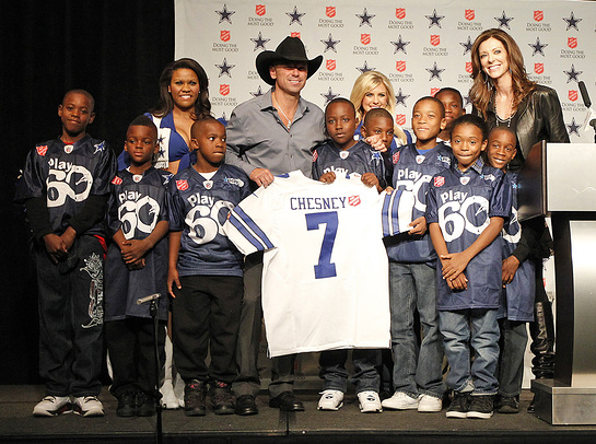 Kenny Chesney announces his halftime performance during the Dallas Cowboys Thanksgiving Day game to kickoff The Salvation Army Red Kettle Campaign.