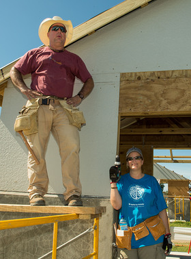 Garth Brooks and Trisha Yearwood joined Habitat for Humanity volunteers to help build 100 houses over the course of one week