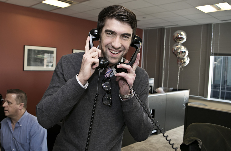 Olympic Gold Medalist Michael Phelps answers the phones on the trading floor at ICAP's North American headquarters.