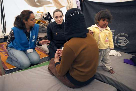 UNHCR Special Envoy Angelina Jolie meets with refugees at the Za'atri refugee camp in Jordan.