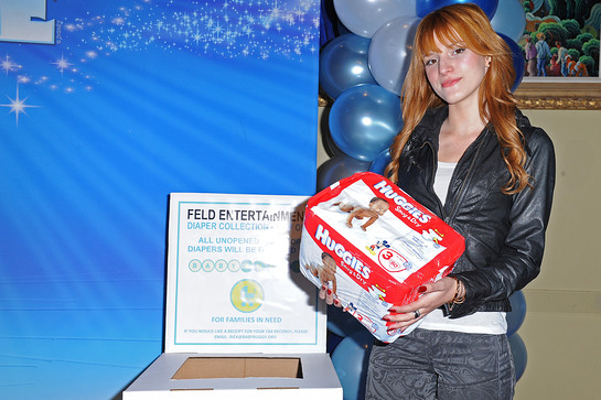 Bella Thorne helps families in need by donating diapers to Baby Buggy at Disney on Ice Dare to Dream Premiere