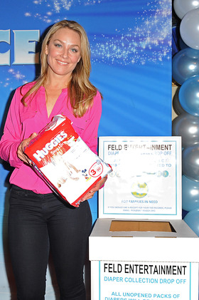 Elisabeth Rohm helps families in need by donating diapers to Baby Buggy at Disney on Ice Dare to Dream Premiere