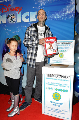 Travis Barker helps families in need by donating diapers to Baby Buggy at Disney on Ice Dare to Dream Premiere
