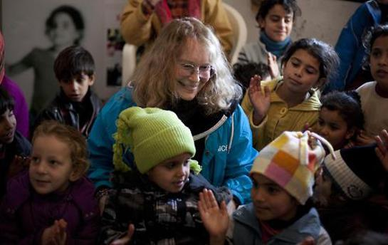 Mia Farrow visits Syrian child refugees in a UNICEF-supported child-friendly space in the northern Wadi Khaled region of Lebanon, near the Syrian border.
