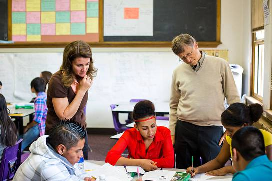 Bill and Melinda Gates, co-chairs of the Bill & Melinda Gates Foundation, work with students at South High School in Denver, Colorado.