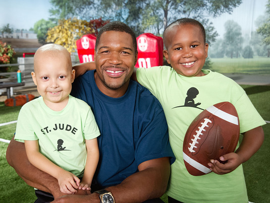 Michael Strahan celebrates St. Jude Game Day. Give Back with patients Estevan and Marion to prepare for the big game.