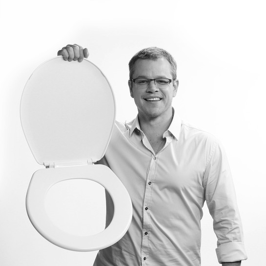 Water.org's Matt Damon holds up a toilet seat in protest of the 2.5 billion people who don't have access to clean water and sanitation
