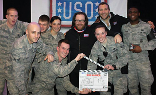 Troops pose with director John Moore, center, and Jai Courtney following the movie.