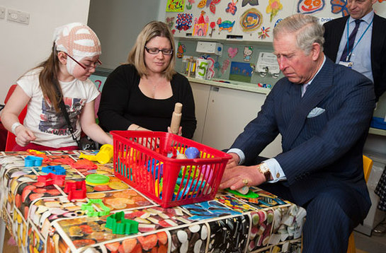 The Prince of Wales rolls out Play-Doh with eight-year-old Katie Tuffin and her mother Emma
