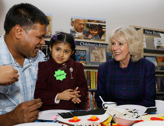 The Duchess of Cornwall meets father and daughter Kabir Miah and Shakira Begum, four, during a visit to West Greenwich Library in London.