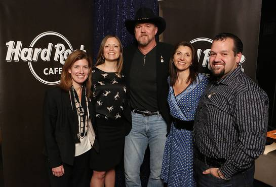 Trace Adkins, center, appears with Red Cross representatives Boo Gonzalez, Jackie Nelson, Selma Bouhl, and Hard Rock representative, John Pasquale
