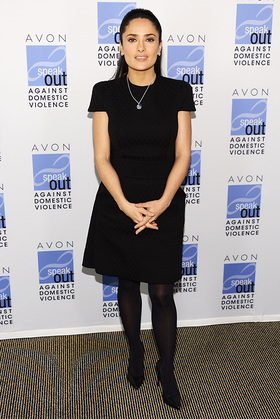 Salma Hayek Pinault wears the new Avon Empowerment Charm Necklace to raise funds to end domestic violence in honor of International Women's Day.