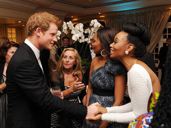 Prince Harry talks to guests at a drinks reception at the Sentabale Gala dinner at the Summer Place in Sandton, Johannesburg