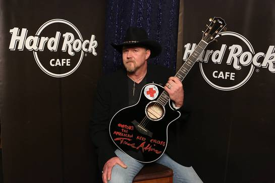 Trace Adkins, donates his hand-painted black Taylor guitar with the globally recognized symbol of the American Red Cross to Hard Rock's world famous memorabilia collection as part of the most recent challenge on NBC's All-Star Celebrity Apprentice