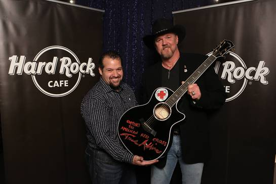 Trace Adkins appears with Hard Rock representative, John Pasquale, as he donates his hand-painted guitar to Hard Rock's world famous memorabilia collection as part of the most recent challenge on NBC's All-Star Celebrity Apprentice,