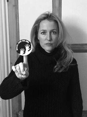 Hollywood star Gillian Anderson brandishes the awáIcon which sends the urgent message, 'Brazil: Save the Awá'.