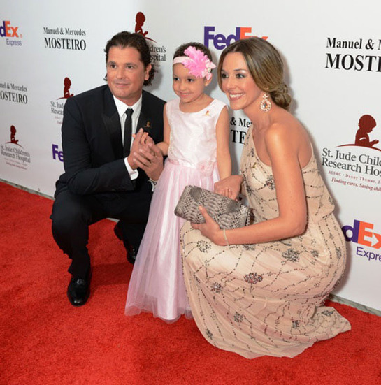 Carlos Vives and wife next to St. Jude patient Izarah at Miami Gala.
