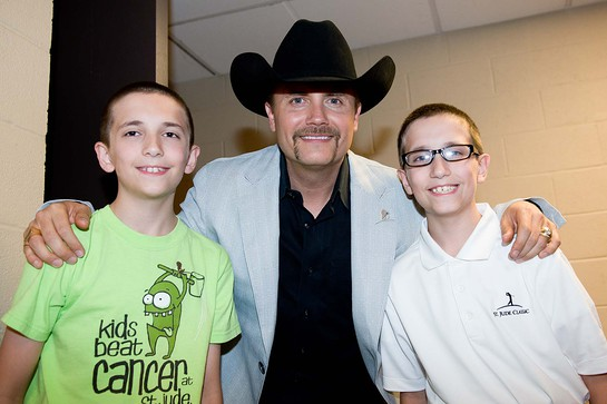 John Rich with St. Jude patient Ethan and his twin brother Cooper